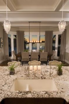 I'm in love with this! I so want just one big open dining area in the kitchen, no separate dining room. Love that table and chairs too!