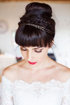 Love this bridal updo with braids. Brides With Buns via @junoandjoy