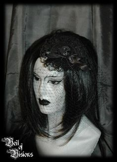 Elegant gothic piece for any occasion! A lovely mix of lace, satin, ribbons, roses, beads and netting! £29
