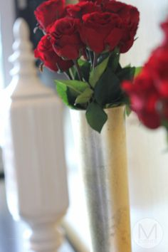 Gold vase with red roses