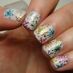 Colorful snowflakes over white nail polish, but I could definitely turn these into fireworks for July 4th!