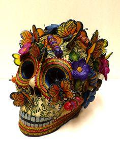 Spectacular Monarch butterflies skull created by renowned Master Potter Alfonso Castillo Orta from Izucar de Matamoros.