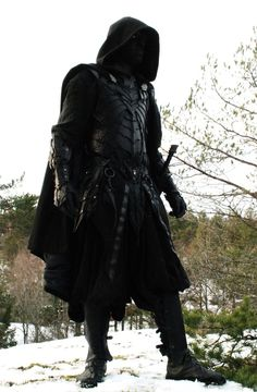 This image of someone doing Drow cosplay was one of my earliest inspirations for the Zhore, although their costume ended up looking a lot less warlike.