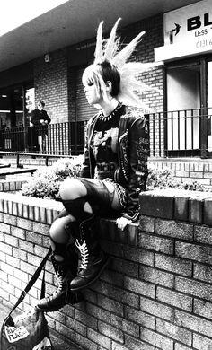 Female punk sitting on a wall with a mohawk, black flag, rancid Piercing Tattoo, Piercings, Punk Rock Girls, Goth Girls, Diesel Punk, Psychobilly, Gothic, Girl Mohawk, Punk Mohawk