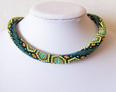 Hey, I found this really awesome Etsy listing at https://www.etsy.com/listing/158655643/bead-crochet-necklace-with-geometric