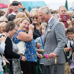 Ever the charmer, Prince Charles chats to a gaggle of giggly women outside the show