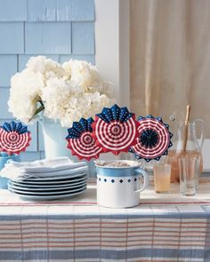 Wave away the heat, and proclaim your allegiance, with these red, white, and blue party favors.
