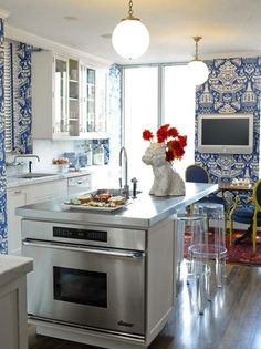 Clever kitchen.  The wall coverings although busy make this kitchen look clean and contemporary.  love it!