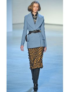 Rodarte collection 2012. This powder blue coat with golden skirt makes us want to go on a glamorous train ride back to the 1940s.