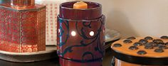 """Add Scentsy style to smaller spaces with the Mid-Size Scentsy Warmer. Available in a variety of styles and colors. Approximately 4"""" wide and 5"""" tall."""