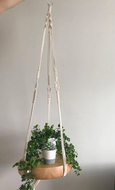 Beautifully simple macrame floating shelf. Price varies depending on the length. The price shown is for the product pictured - this one is 3.5 feet long and DOES NOT include the wood shelf & plants.