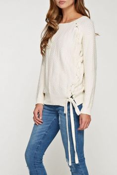 This Chloe sweater by Lovestitch features beautiful knit work round neckline long sleeves criss-cross side design finished with a side tie ribbon! This just might be your favorite piece in your closet this season!  Chloe Sweater by Lovestitch. Clothing - Sweaters Los Angeles California