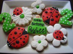My friend's cookie business in Grapevine, soooo cute! Lady bug birthday cookies! by Kiwi's Kookies