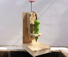 DIY Drill press: Anyone who works with wood knows you have to make hundreds of holes for the screws and its almost impossible to make a series of holes perfectly straight and with ...