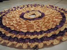 Ruffled Christmas tree skirt made with gold and purple ribbon