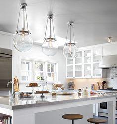 White, marble, industrial stools, skylight | Rejuvenation