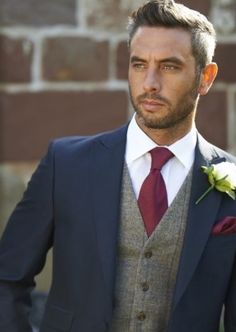 Groom and groomsman suits in navy and maroon                                                                                                                                                      More