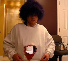 Gaping Hole Costume: You can create a nice scary effect with nothing more than a portable DVD player and portable camera. Just attach to the front and back of a sweatshirt, and voila!