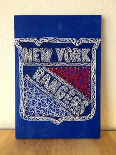 This New York Rangers String Art is completely hand strung with white, blue and red string. The background is blue. It makes for a unique gift
