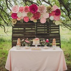 "Inspired By This on Instagram: ""What's more fitting for a girly baby shower than a backdrop made out of pink paper flowers?! This pretty farm baby shower is #onIBTtoday (Link in Profile, Planning: @Kate_Rose_Creative_Group, Photo: The Studio on Austin, Paper flowers: @paperflora, Cake: @simplydeliciouscustomcakes)"""
