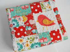 Baby Girl Quilt Red and Turquoise Bird and Flower. $115.00, via Etsy.