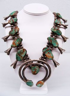 "Early Antique (pre 1950) Navajo Sterling Silver Royston Turquoise Squash Blossom Necklace - This is natural mined turquoise from the Royston mine in Tonapah, Nevada. This squash blossom necklace has 10 blossoms each measuring 2"" x 1"" and a fabulous Naja pendant measuring 3"" diameter. This necklace is 26"" in length and Total weight is 6.35 troy ounces. $960"