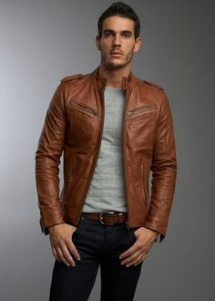 Red-Brown leather jacket Outfit. Cream or grey sweater shirt, brown belt, dark jeans.