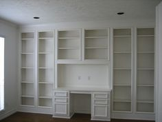 study with built in desk and shelves