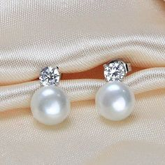 Theses will match my necklace.  Simple since the necklace is such a statement piece.  White genuine freshwater real pearl earring studCubic by PearlOnly.