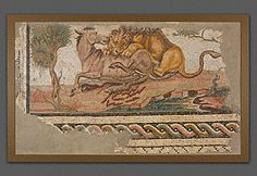 """Circa 150 AD stone & glass floor mosaic: lion attacking an onager (wild ass); 33 3/4"""" x 57 13/16""""; Getty 73.AH.75. Per Getty: 2nd AD Roman province Africa (incl modern Tunisia) flourished: trade, politics, wealth, power = arts; more Tunisian mosaics survive than any other part of Roman Empire. This mosaic formed of tesserae (marble, stone, glass sent in mortar); border on 2 sides, but original setting on other sides unknown; size suggests emblemata w/in larger floor? Ancient repairs to…"""