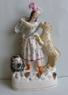 Staffordshire figurine of 'The Lion Queen Ellen Bright' who - sadly - was killed by a tiger at the age of 16.