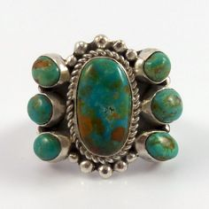 Sterling Silver Ring set with a Cluster of Royston Turquoise from Nevada. Ring Size: 8.25 Band Width: .25""