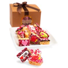 Romantic Mini Krispie - Gift Box of 12, 24, or 48 - $24.95 -  	 These delicious chocolate dipped Krispie Treats are a sweet token for your sweetheart! Your cookies are wrapped in your choice of decadently delicious fine gourmet Belgian Chocolates - dark, milk or white - and decorated with hand-crafted Royal Icing Hearts and Bears and a generous sprinkling of candy hearts. Each cookie is tucked inside a clear cellophane bag, and heat-sealed at both ends for freshness and quality.