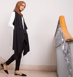 INAYAH | Match the Black #Sleeveless #Cover with the Deep Copper #Maxi Silk Chiffon #Hijab and Black Crossover #Trousers. Model is also wearing the classic White Crepe Top - www.inayah.co