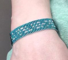 Do you and your friend have a secret message that only you two know? Well, stamp it on a bracelet in Morse code using beads with this Morse Code DIY Beaded Loom Bracelet.