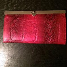 Girls night out clutch/wallet! Good as new pleather wallet/clutch. Metal slide clasp. Zipper compartment in middle. White smudge on bottom back but barely noticeable. Great to use as a fun wallet in a large purse or as a hand clutch for a night out! Maurices Bags Wallets