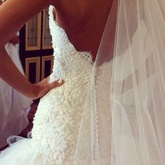 The lace, the buttons down the center back,The pearls, Fantastic and gorgeous