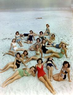Swimwear fashion [1950s] Think this is the era I should have been born in... Always loved the style of these costumes and my hair naturally grows to most of these doos anyhow!