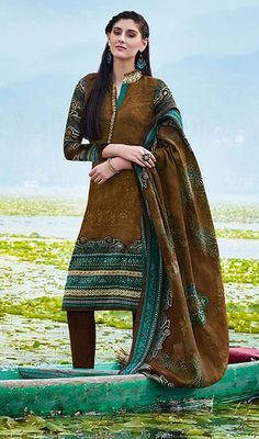 Break the monotony donning this brown color pashmin churidar kameez. You could see some fascinating patterns accomplished with lace and printed work. #printeddressonline #onlinesalwarkameez #onlinesuits