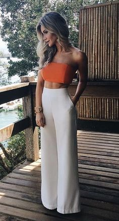 summer outfits outfits for the beach outfit for vacation days white high waisted pants orange strapless top with white pants outfit palazzo pants outfit womens fashion womens wear trendy outfits Palazzo Pants Outfit, White Pants Outfit, White Palazzo Pants, Dress Pants Outfit, Orange Top Outfit, Wide Leg Pants Outfit Summer, Bustier Top Outfits, Summer Pants Outfits, All White Outfit