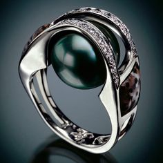 RANDY POLK DESIGNS: STAINLESS GALLERY 2 Black Tahitian Pearl, Inlay of Petrified Palm Tree, 23 pave Diamonds