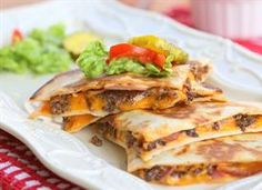 Mexi Cheeseburger Quesadillas      All of your favorite hamburger toppings nestled with cheese inside a tortilla