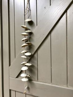 Blij om dit item uit mijn shop te delen: Beautiful handmade ceramic mobile, windchime or wallhanging with three strands with beige speckled domes, finished with a white shiny glaze Wind Chimes, Beige, Ceramics, Handmade Ceramic, Strands, Etsy Shop, Beautiful, Ceramica, Pottery