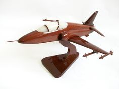 """A beautiful hand carved desktop model of the Hawk. The model has been carved from solid mahogany. The model comes boxed and is simple to assemble. The wings, tail fins, stand and rotas simply slot into pre-drilled holes on the body of the aircraft. No glue required. Size H 9"""", L 16"""", W 12"""". Visit our website at http://www.thewoodenmodelcompany.co.uk to view the full range of our models."""