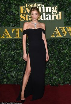 Thigh's the limit! Lily turned heads as she arrived wearing a thigh-skimming black dress...