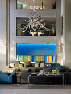 The lobby features a beautifully designed frontdesk by Mexican-artist Orfeo Quagliata and the mirrored glass chandelier was created by Italian-artist Massimo Micheluzzi.