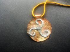 mixed metal celtic triskele pendant by blackjadecrafts on Etsy