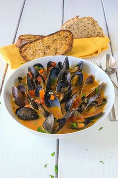 Mussel soup. A rich tomato based broth, with wine, garlic and fresh parsley.  Serve with crusty bread and you have a quick and easy meal in under 20 minutes.