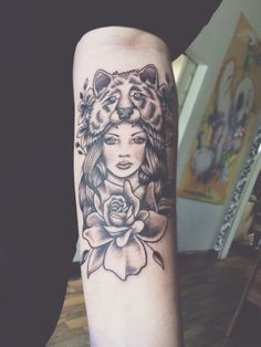 Black and grey girl with wolf on headdress forearm tattoo