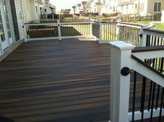 Trex transcends deck ropeswing color with vintage lantern for Fiberon decking cost per square foot